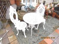 Pair Of Cast Iron Garden Table And Chairs
